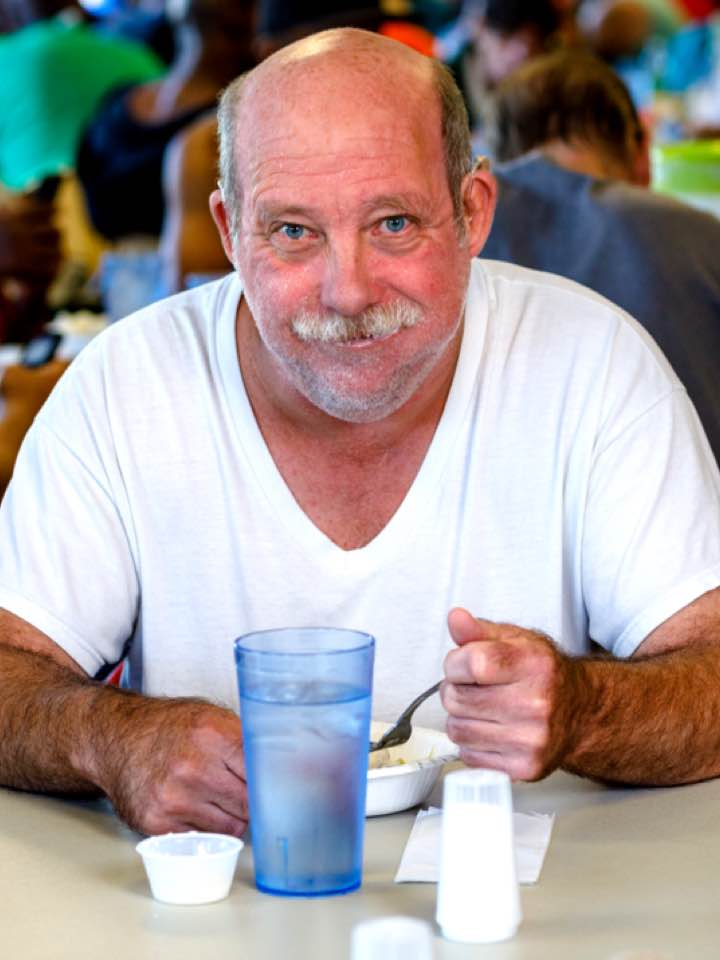 Jim enjoys a meal at City Gospel Mission
